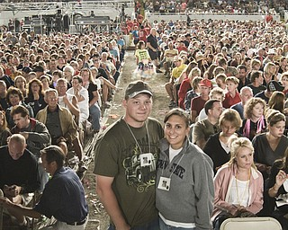 Bob Brenner, Jr., 23, and Leah Eister, 22, both of Canfield, await Josh Tucker in the front row of the grandstand auditorium at the Canfield Fair Sunday, August 31, 2008. Daniel C. Britt.