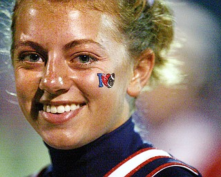 TRUE COLORS: Melissa Lynn, an Austintown Fitch junior who performs double duty as a cheerleader and band member, shows off her school pride during the Falcons' home game against East.