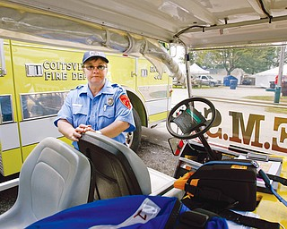 FAIR FORCE: Karen Davis of Coitsville, a firefighter, nurse and emergency medical responder, said the team at the Canfield Fair has a cart equipped with a medical bed, automated external defibrillator and portable water tanks, as well as full fire gear.
