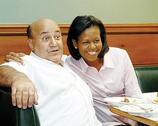 TABLE TALK: Michelle Obama shares a memorable moment with Phillip Raptis of the Yankee Kitchen Family restaurant in Boardman. Before their breakfast, her husband, Democratic presidential hopeful Barack Obama, stopped in for a workout at Fitness One in niles.