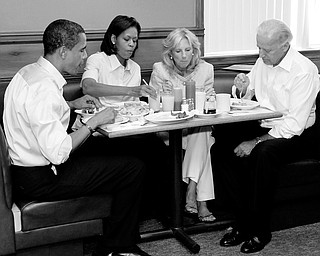 WAFFLES, BACON, EGGS: Barack Obama had waffles, bacon and two eggs over medium at the Yankee Kitchen Family Restaurant in Boardman. Joe Biden ordered the French toast. With them Saturday morning are their wives, Michelle Obama and Jill Biden.