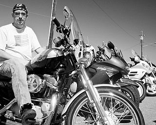 BIKES GALORE: Motorcycle enthusiast Donald Husk of Warren attended Sunday's car show.