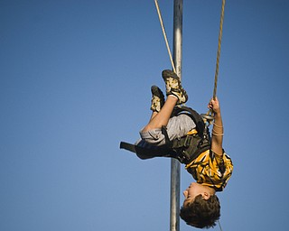 Dakota Bartells, 7, of N. Lima flips around the Fair on a bungee harness. Daniel C. Britt.