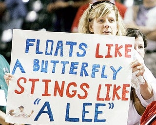 PROGRESSIVE SUPPORT: An Indians fan holds up a sign after her team defeated the White Sox on Monday at Progressive Field. Starter Cliff Lee tossed a five-hitter for the Tribe.