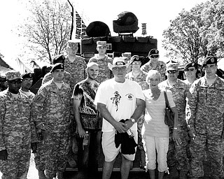 MILITARY SUPPORT: Middleweight Champion Kelly Pavlik and his parents, Mike and Debbie Pavlik, pose with members of the 583rd Law and Order Detachment and the 838th Military Police Company, both based out of Austintown. The troop members served in Iraq. Pavlik wore boxing trunks featuring an American flag with the insignias of the five branches of the military for his June bout with Gary Lockett.