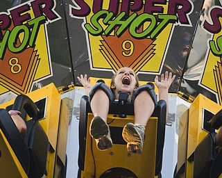 Jessica Jacobs, 11, of Ellsworth free falls on the Super Shot ride at the Canfield Fair. Daniel C. Britt.