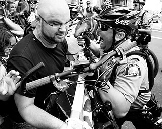 St. Paul police officers push back a group of protesters who were using a large sign during an anti-war protest at the Republican National Convention in St. Paul, Minn., Monday, Sept. 1, 2008.  (AP Photo/Matt Rourke)