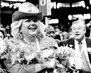 HAVING A GOOD TIME: Alternate Ohio delegate Kathy Eshelman of Dublin, Ohio, reacts to the speeches with others during the Republican National Convention in St. Paul, Minn. She was appropriately attired in political regalia for the event Wednesday.