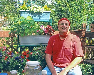 Rick Miller has a flower garden at his home in Austintown. The photo is from Virginia Miller of Youngstown.