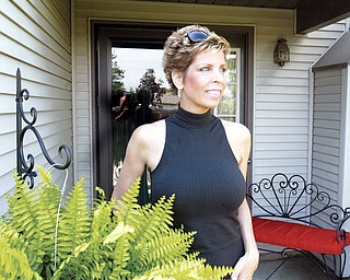 SURVIVOR: Lori Marsh of Canfield, who was diagnosed with Leukemia last July, is in remission and plans to return to work this week.