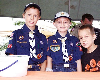 SCOUT'S HONOR: Three members of Cub Scout Pack 119, from left, George Conrad, Adam Van Tassel and Isaiah Kohl, stop by a food stand during the Fall Fest in New Middletown. They were there Saturday.