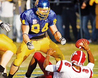 GROUNDED AGAIN: South Dakota State noce tackle Brian Fischer (94) celebrates his sack of Youngstown State quarterback Brandon Summers (6) for a safety in the second quarter of Saturday's game in Brooking's, S.D.