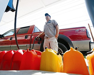 IKE PREPARATION: Sean Eitneiser fills his truck and gas cans with fuel at a station in Islamorada, Fla. Officials in teh Florida Keys started a phased evacuation for residents Sunday morning after telling visitors a day earlier to get out. Hurricane Ike was forecast to affect the Keys sometime this week.