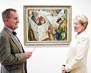 """Evan and Suzanne Morris of Marlboro in Stark County appreciate Clyde Singer's painting """"Early Edition"""" at the Butler Institute of American Art in Youngstown. The people in the artwork are reading The Vindicator."""