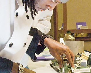 Ray Lewis of the Tapazza restaurant in Boardman slices up seared tuna.