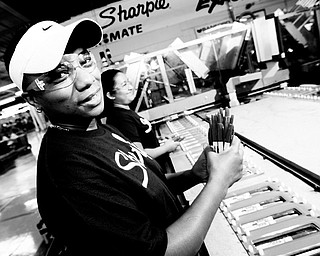 POWER OF THE PENS: Tina Hamler, front, and Griselle Garcia work on the Sharpie marker packaging line as they place colored Sharpie Retractable fine-tip markers into plastic packaging at the Newell Rubbermain Sharpie Manufacturing Plant in Shelbyville, Tenn. The company retooled ingredients for their plastic products such as Sharpies because of high fossil fuel costs.