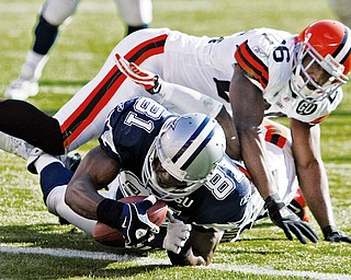 SCORE FOR COWBOYS: Dallas Cowboys wide receiver Terrell Owens (81) dives over the goal line under Cleveland Browns safety Sean Jones for a 35-yard touchdown reception in the second quarter of Sunday's game at Cleveland Browns Stadium.