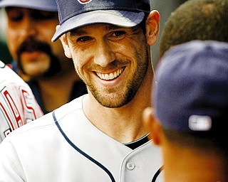 ALL SMILES: Cleveland Indians pitcher Cliff Lee smiles as he walks through the dugout after being replaced in the eighth inning of Sunday's game at Kansas City. Lee picked up his 21st win of the season in the Indians' 3-1 victory.