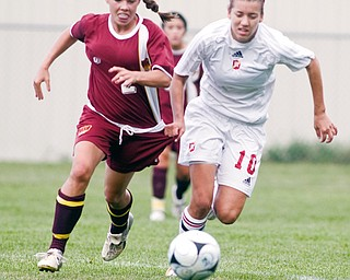 MOONEY CAPTAIN: Ashley Cuba, right, of Cardinal Mooney battles for possession of the ball with Walsh Jesuit's Kaylee Semeisberger during Saturday's game at Valley Sports. Cuba, a Mooney captain, says teh Cardinals' difficult schedule should prepare them well for a long tournament run.