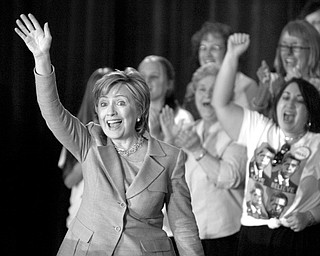 SUPPORTING OBAMA: Sen. Hillary Rodham Clinton, D-N.Y., waves to cheering supporters as she takes the stage to deliver remarks at a community event for the Barack Obama campaign in Kissimmee, Fla. Clinton campaigned for OBama in Central Florida and Tampa on Monday.
