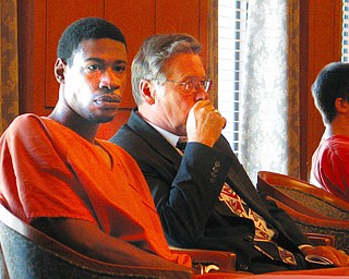 COURT DATE: Adreen I. Mitchell and his attorney, James Lewis, of the Ohio Public Defender's Office, listen to proceedings in Trumbull County Common Pleas COuty. MItchell was present for an initial appearance Monday; he is charged in the slaying of Fred A. DeVengencie, 89, owner of Freddie's Diner in Warren; and the wounding of Fred's son, Anthony DeVengencie, 71.
