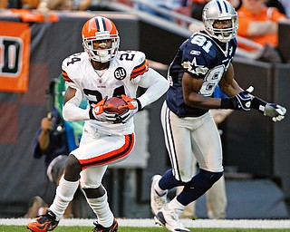 A BRIGHT SPOT: Cleveland Browns cornerback Eric Wright (24) intercepts a pass in the end zone intended for Dallas Cowboys wide receiver Terrell Owens (81) in the third quarter of Sunday's game at Cleveland Browns Stadium.