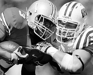 FACE-TO-FACE: Ohio State running back Brandon Saine (3) is tackled by Ohio defensive lineman A.J. Oxley in the third  quarter of Saturday's game at Ohio Stadium in Columbus.
