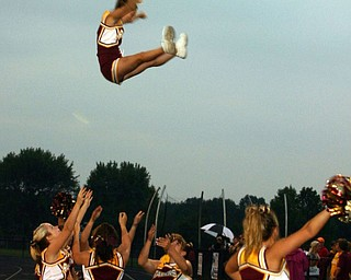 """""""Whitney Gould is caught by her fellow South Range cheerleaders Christina Oddo, Rachel Kelly, Melissa Williams, and Julianne Dundee."""