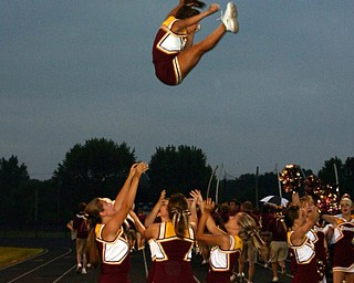 """""""South Range cheerleader, Danielle Pendice, flies high with the help of fellow cheerleaders Brittany Haynes, Jesse Heck, and Courtney Driscoll."""