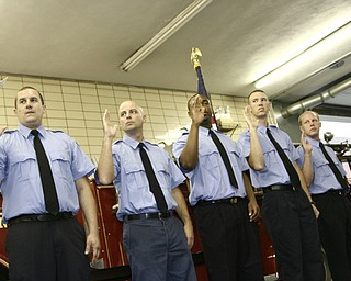 ON THE JOB: Five new firefighters took the oath Friday to serve on Youngstown's fire department. They are, from left, Jonathan Racco of Austintown, William Palma of Boardman, Andre Miller of Youngstown, Jeffrey Kaschak of Canfield and Daniel Jamison of Girard.