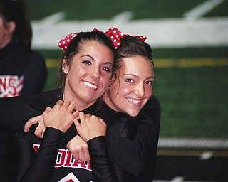 time out for a picture varsity cheerleaders Julia Guerrieri and Giovanna DelGarbino