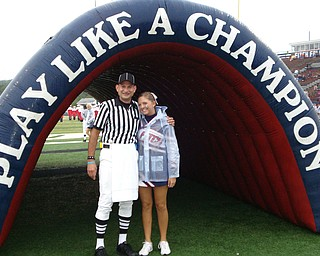 Official Jim DeNunzio and Cheerleader Cassandra Miller take a quick pic before game time!