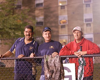 TOM HARKLERODE, RAY CARLSON AND JOHN HVIZDAK POSED FOR A PICTURE AS THE LOWELLVILLE ROCKETS BEAT JACKSON MILTON 27 TO 0.