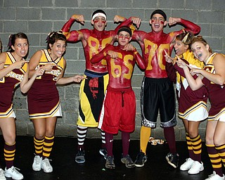 """""""South Range Varsity cheerleaders point out athletes supporting the football team.  Basketball player Joe Milan and wrestlers Jared Miller and Beau Bowden painted their jersys on and are cheering the team onto victory against Sprinfield."""""""