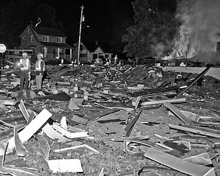 Debris from the blast covered neighboring houses and lawns. Daniel C. Britt.