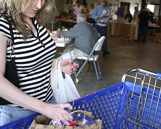 Kelly Fredrick of Austintown has been a volunteer at Second Harvest Food Bank for 3 years. She is dropping off food she's donating.