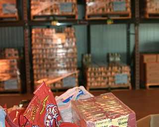 High stacks of cereal and other various food are piled in at Second Harvest Food Bank in preparation to be sent out to families in need.