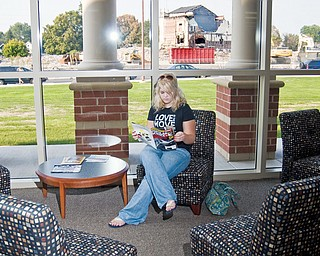 Corrie Romesburg, 17, a Senior at the new high school this year waits for her mother to finish a tour in the new library which boasts new furniture, a computer lab and for limited time, a view of the old building.