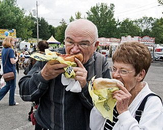 WHAT A BRAT: It's not Oktoberfest without fresh bratwurst. Jerry Compton and Peggy Ault, both of Boardman, couldn't resist savoring the traditional sausage meal, complete with onions on top.