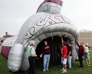 The Boardman High School Gridiron Club is seen with the large, inflatable tunnel the organization purchased for the team to emerge from during pregame entrances.