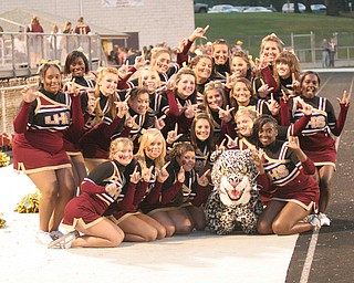 The Liberty High School Cheerleaders and the Leopard's mascot (Cody Smith)