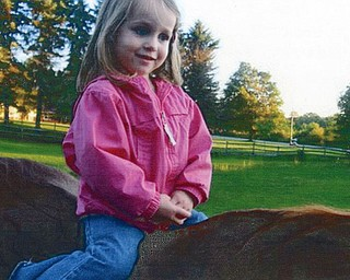 Ava Stankovich, 3, from Columbus, loved her first ride on a horse while visiting her grandmother, Eileen, in Youngstown. Photo submitted by Mary Sigel, friend of the family.