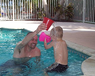 Ryan Matey with Uncle JT Joyner (from Kent, Ohio) having a water fight in the pool on vacation in Key Largo, Fla. Sent by Kelly Matey, New Springfield