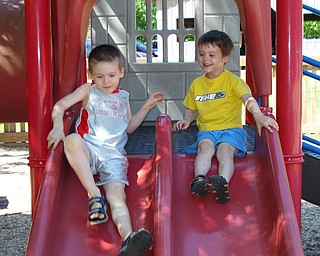 Brothers, Aidan (5) and Liam (3) Murphy, sons of Kevin and Theresa Murphy of Bezetta Township, have a fun day at Boardman Park.  They had spent the day with Mrs. Miller, teacher at Ursuline High School, reading at the library as part of the summer reading program and having some fun on the slide!