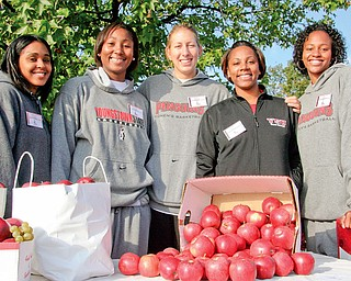 HELPING HANDS: Monique Godfrey, Ashley Pendleton, Rachel Manuel, coach Deidre Jones of Boardman and Tiara Scott of the women's basketball team came to help hand out snacks and T-shirts during Saturday's Coaches vs. Cancer 3-mile walk at Youngstown State University.