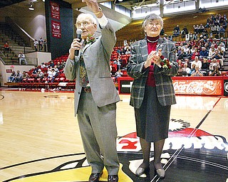 Former YSU basketball coach Don Rosselli speaks to the crowd gathered at Beeghly Stadium while being honored. Don's wife of 62 years, Connie, stands by his side in center court.