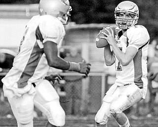 Matt Shelton looks to throw to Andre Givens during Friday game at Lakeview.