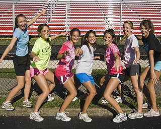 Canfield Cardinals Cross-Country Girls: L-R, Jillian Smith, 16, Elizabeth Wilkens, 16, Katie Tiberio, 15, Nicole Tiberio, 15, Shannon Reed, 18, and Cathyrn Zetts, 15, and Marla Marucci, 15, all of Canfield. Daniel C. Britt.
