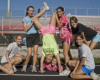 Canfield Cardinals Cross-Country Girls: L-R, Cathryn Zetts, 15, Jillian Smith, 16, Elizabeth Wilkens, 16, Shannon Reed, 18, Katie Tiberio, 15, Nicole Tiberio, 15, and Marla Marucci, 15, all of Canfield. Daniel C. Britt.