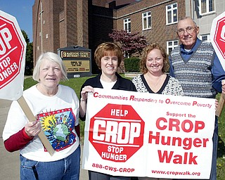 TAKING STEPS TO WALK: Promoting the annual CROP Walk that'll take place Sunday are, from left, Shirley Megown, president of Church of Women United, which supports the event; the Rev. Joyce Lawson, CROP Walk coordinator; Monica Spelich, walk treasurer; and Jack Ritter, president of the Mahoning Valley Association of Churches, walk sponsor.